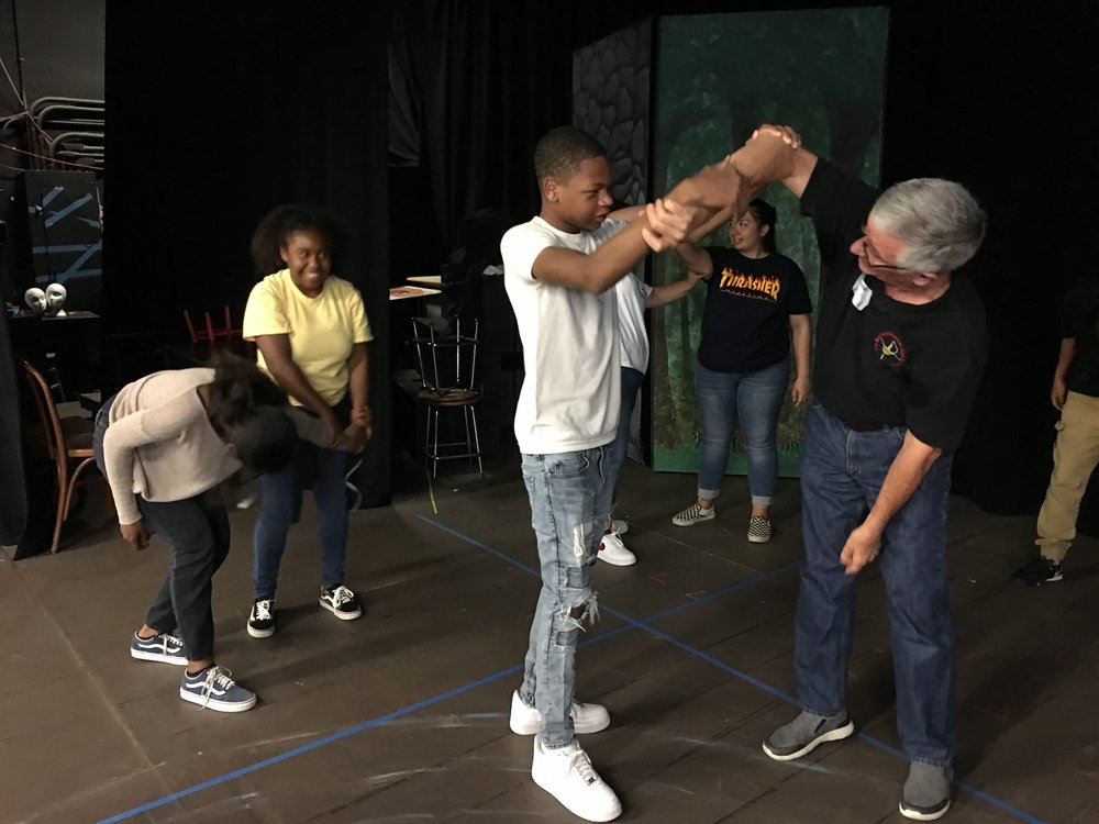 Dr. Stephan Gray, certified fight director demonstrates safety in stage combat during a 6th period workshop series.. Dr. Gray has taught and administered in colleges, universities and regional theatre programs across the country. We are very fortunate to have his expertise!