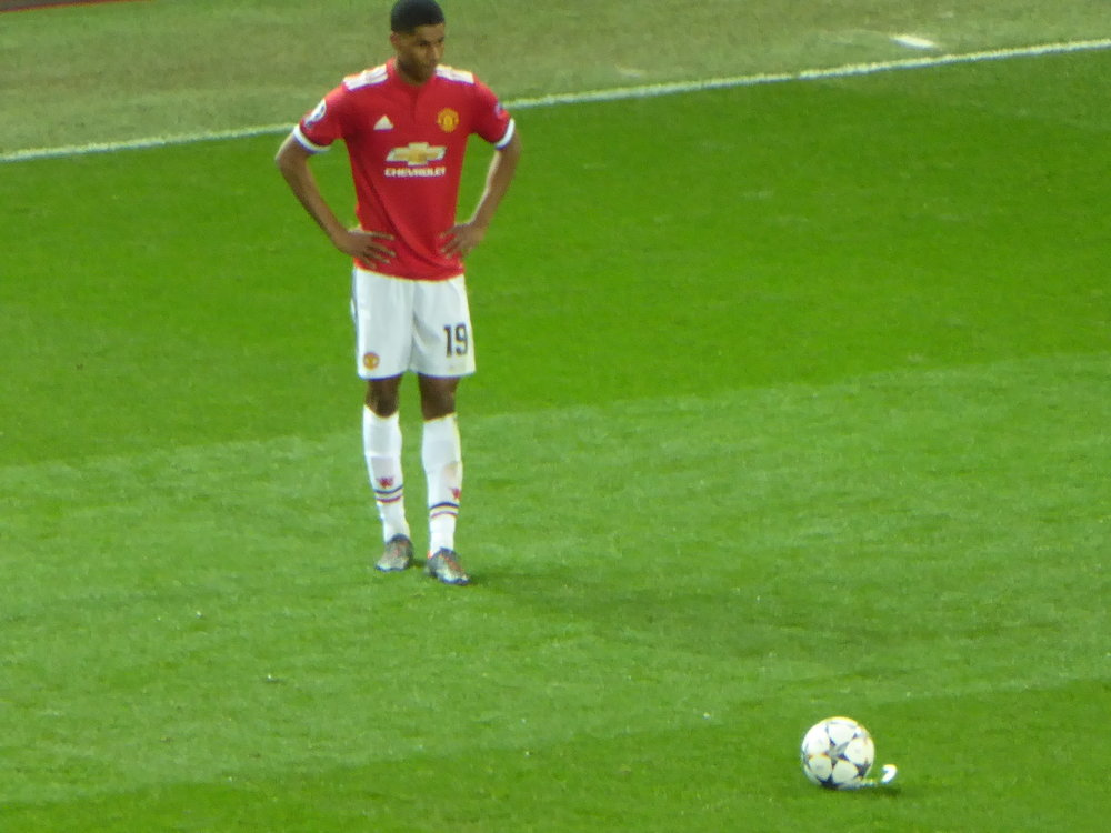 Marcus Rashford (above); The Busby Babes and Manchester United's treble winning side (below).
