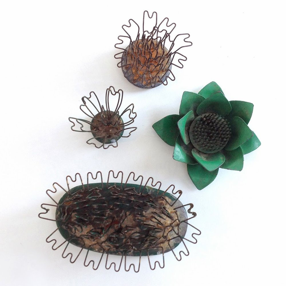 https://www.etsy.com/listing/177700712/lot-of-four-vintage-metal-flower-frogs?ref=shop_home_active_18