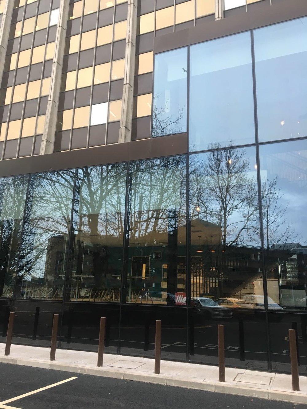 - The structurally glazed curtain wall system is comprised of high performing glass units. The fully glazed entrance foors feature bronze anodized copings above, likewise the internal stair soffet cladding is fabricated from the same bronze anodized aluminium, pressed into panels all designed and installed by Elford, creating a fluent minimalist look whilst giving an impressive focal point to the building.