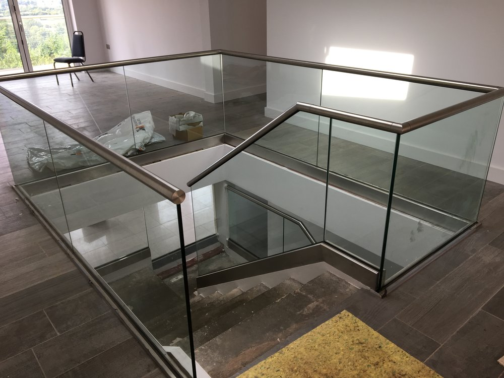 - Elford also provided internal clear glass balustrading around the feature gallery landing and to the central stair-well, giving a light contemporary look in keeping with the rest of this stunning property.