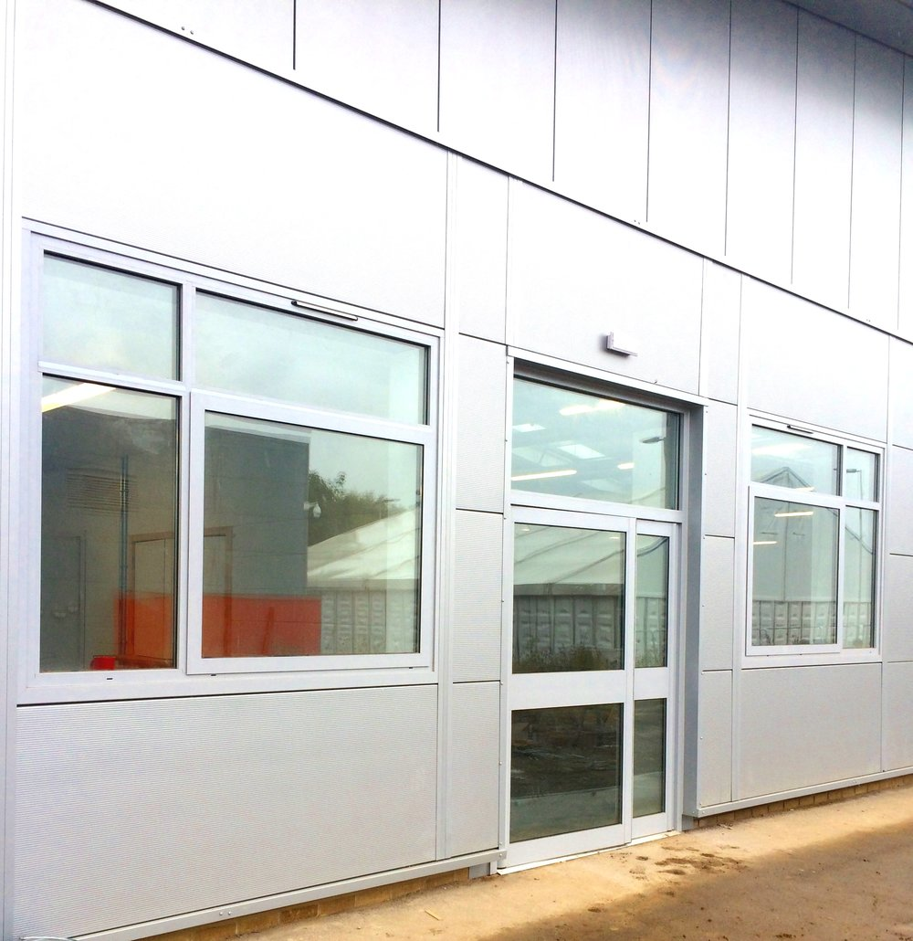 - Elford were contracted to design, supply and install flush fitting sustainable aluminium windows into Kingspan cladding facade, along with fire exit and automatic entrance doors.