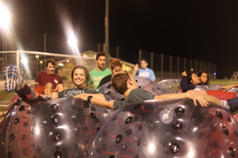 BUBBLE SOCCER - Promotes teamwork and many laughs. Allows the members to have a chance to compete and work together outside of a professional setting.