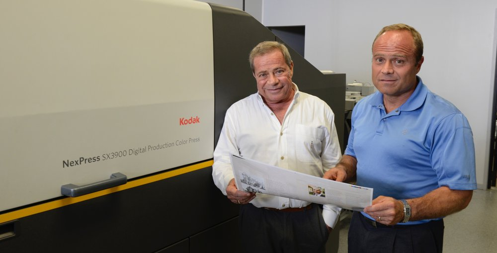 Skip DeBiase, founder of Phoenix Graphics, at left, with his son, Sal DeBiase, who continues his late father's legacy today at the five-generation family printing company.