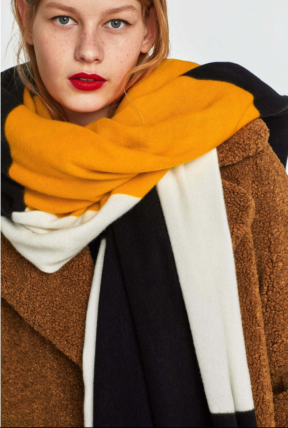 2. the geometric one - ZARA: Geometric Design Scarf, £17.99We absolutely adore this scarf (and low-key blanket?) from Zara. Keep the rest of the outfit simple and let the bold print do the talking.