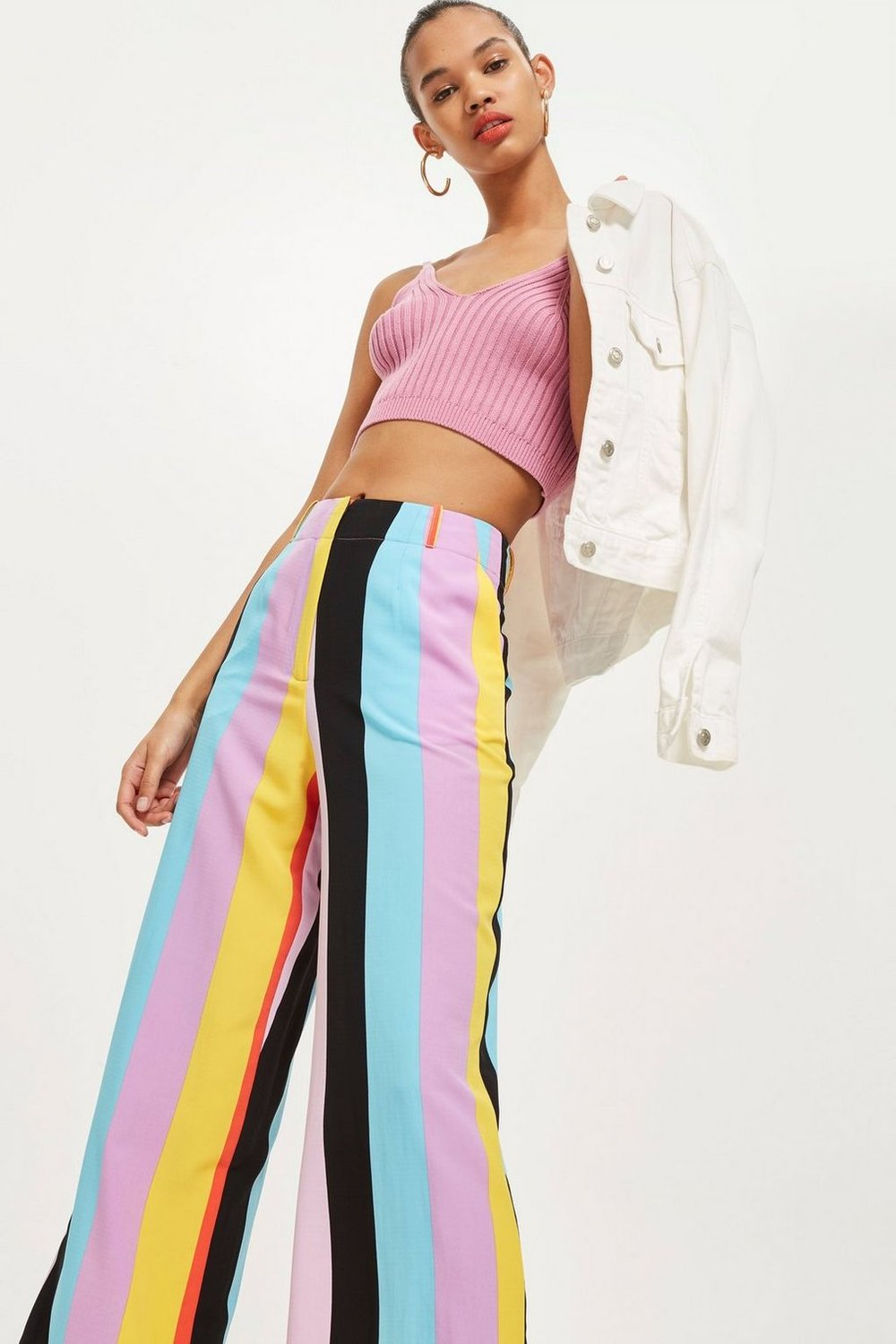 3. the slouchy trousers - TOPSHOP: Rainbow Slouch Trousers, £39Add a pop of colour to your outfit with these high-waisted wide-leg trousers from Topshop. Perfect for when it's too cold for a skirt but too warm for tights, pair them with platform trainers and a fitted tee.