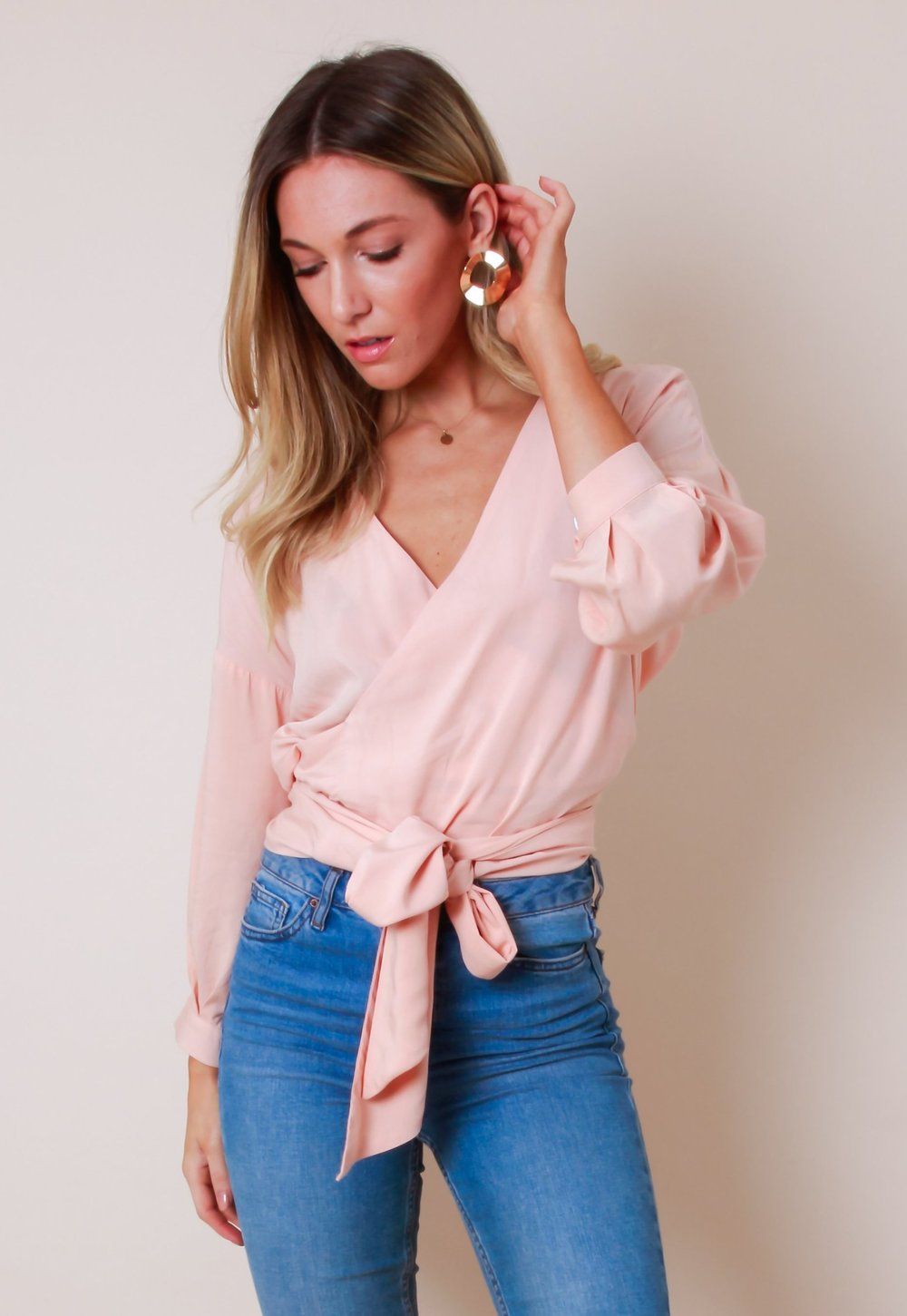 5. the blouse - PRETTY LAVISH: Wrap Tie Blouse, £38Too cold for a vest, too warm for a jumper; blouses are therefore your go-to formal piece. Wear with black skinny jeans and block heels for an easy dressed-up look.