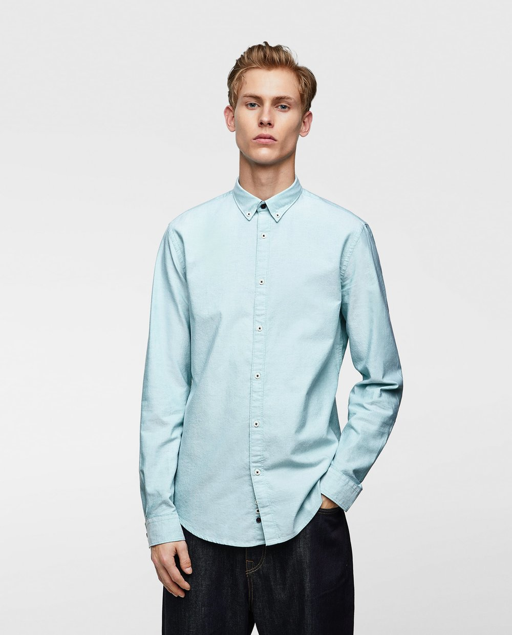 1. THE SHIRT - ZARA: Plain Oxford Shirt, £19.99Keep it simple with this slim-fit Oxford shirt. Pair with black jeans for a smart day look, or under a blazer for a more formal look.