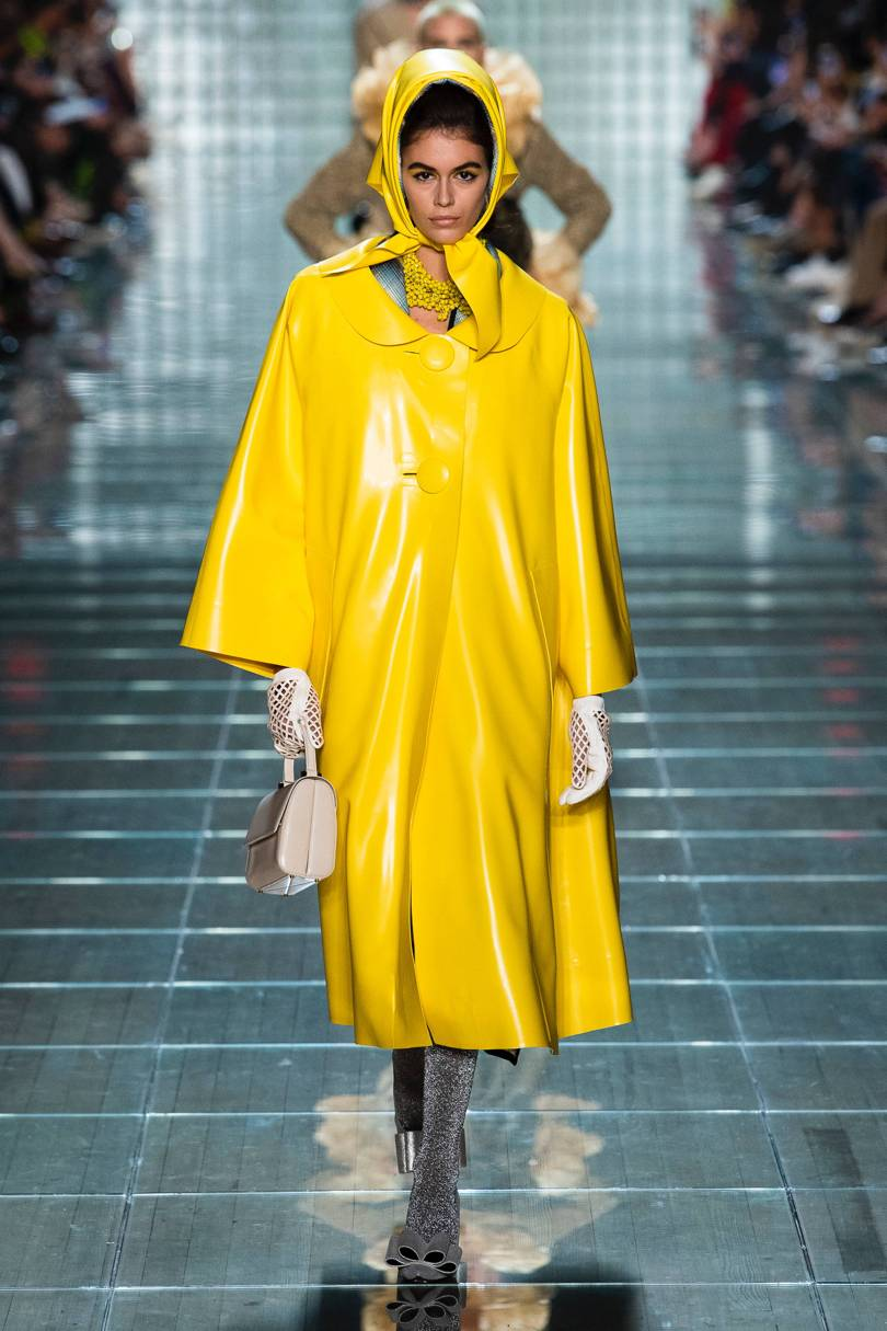 1. Marc Jacobs - This vintage-inspired vinyl will no doubt cause a plethora of yellow rain macs to hit the high street. The addition of net gloves, bow-toed heels and a demure handbag is a very ladylike nod to the 1950s and beyond.