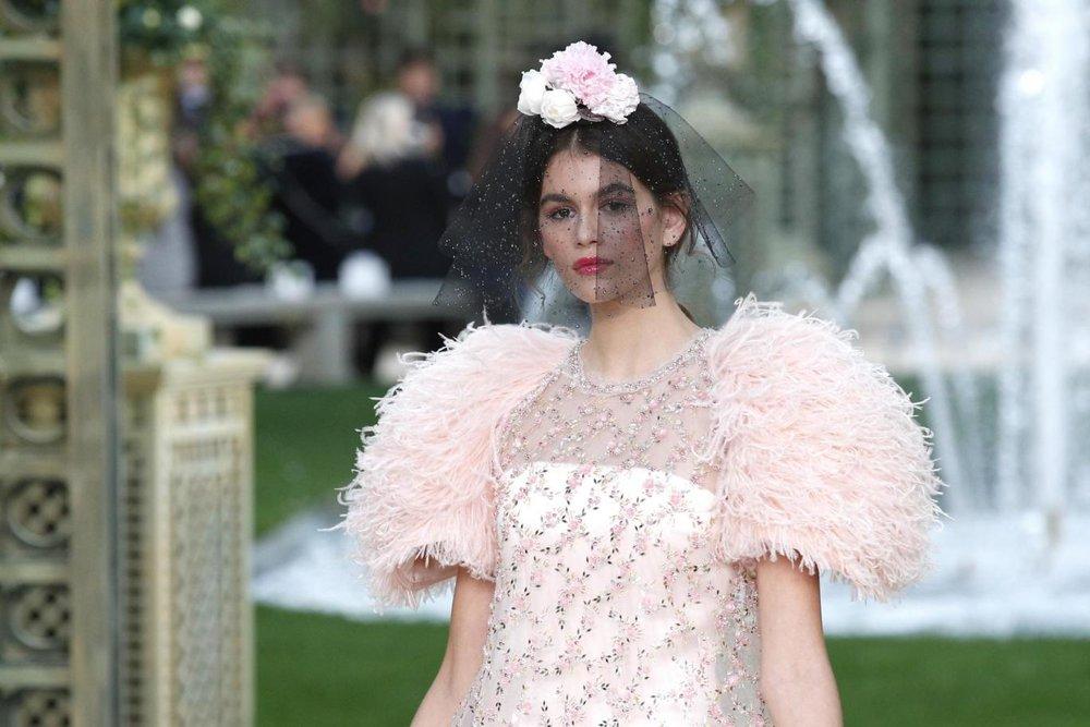 SOURCE:  https://www.standard.co.uk/fashion/news/chanel-ss18-haute-couture-fashion-week-paris-2018-karl-lagerfeld-kaia-gerber-a3747161.html