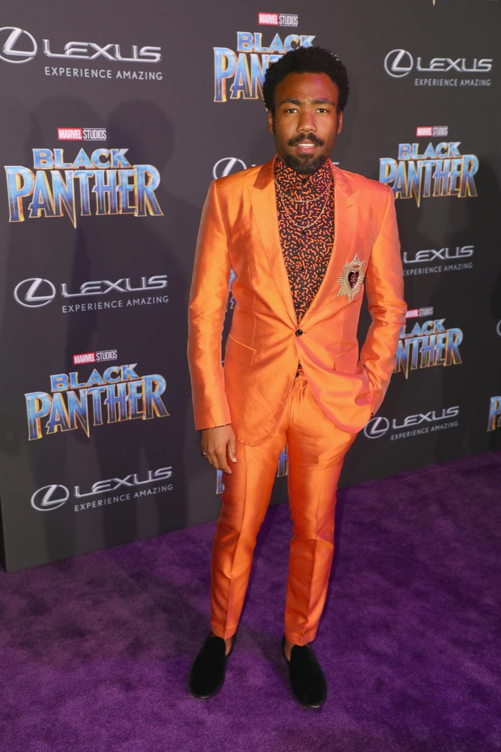 Wearing bright jewel tones at the premiere of 'Black Panther'   Image Credit
