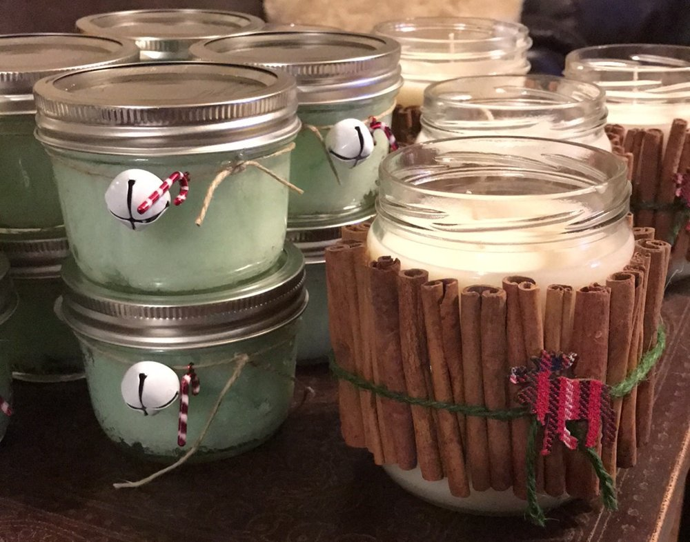 Have yourself a relaxing little Christmas... - It's darn near a fact that everyone loves a good candle. But pairing it with a fabulous sugar scrub? Perfect. These 16oz candles smell just like Christmas. Which is probably why the oil is named