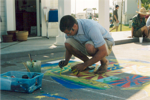 Andy (age 20) working hard on his street painting. (Seaside – April 1998)