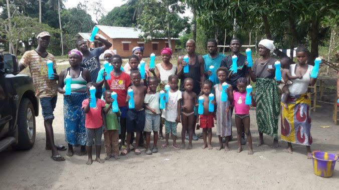 Community members pose with their new water bottles.