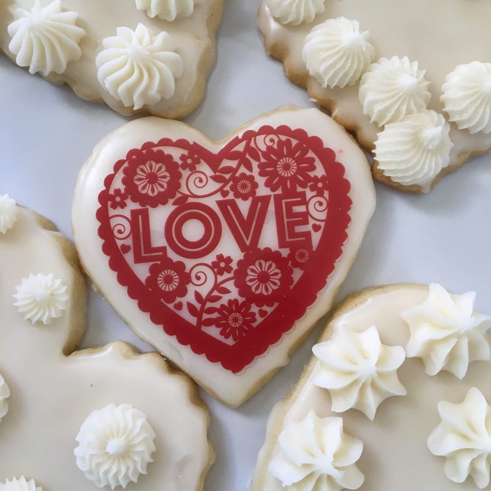 Beautifully decorated, heart-shaped cookies.