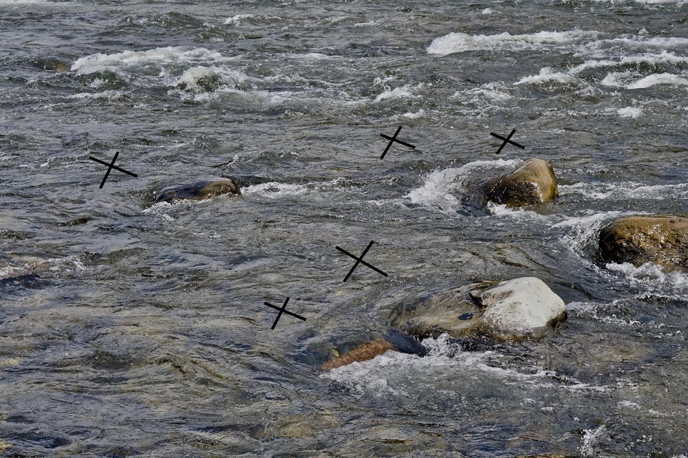 X marks the spot. Even submerged boulders will have a soft upstream pocket.