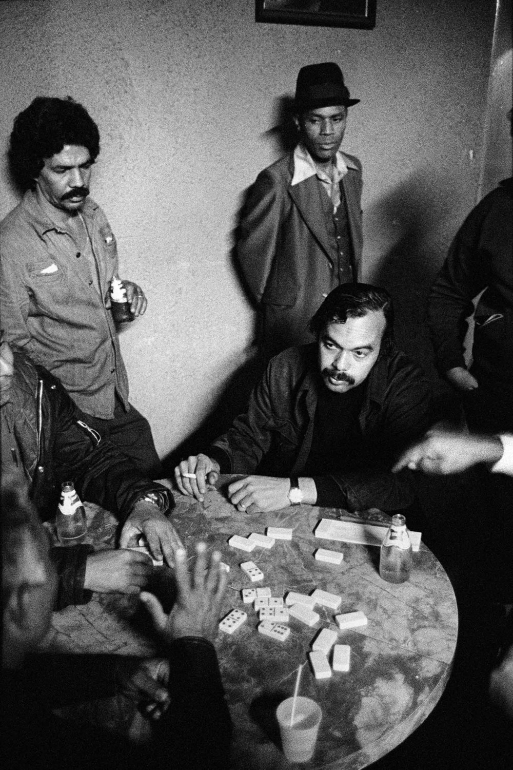 Elmie, seated at dominoes table, 1977