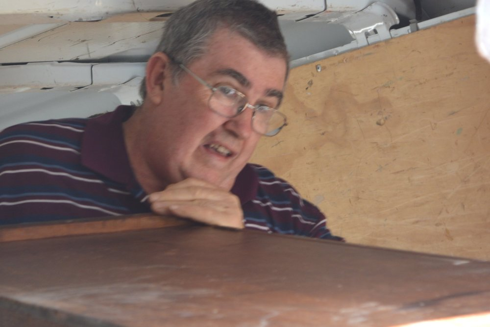 Phil, the Op Shop Manager, loading furniture for one of our partners