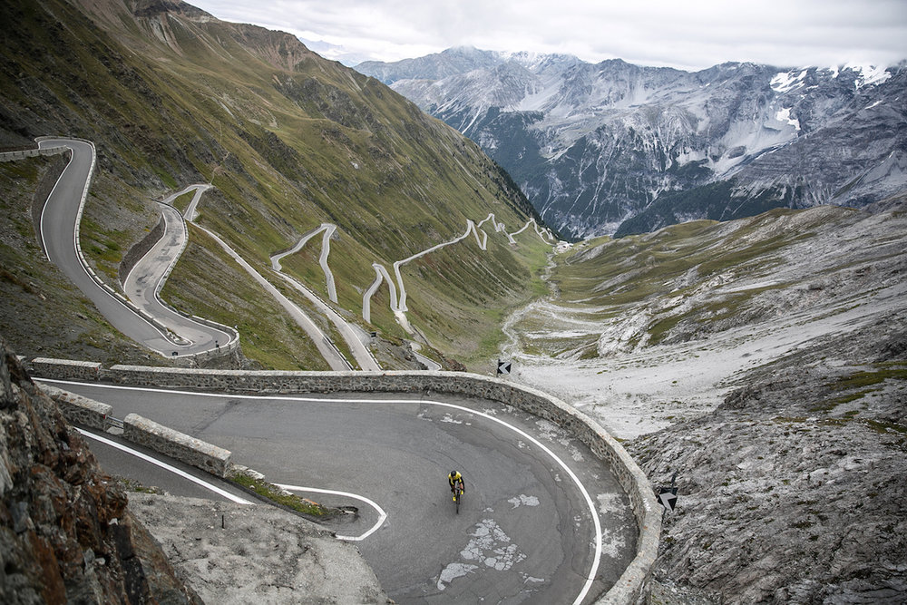 Mike Climbing The Stelvio Pass,a mountain pass in northern Italy,elevation of 9,045 ft. It is the highest paved mountain pass in the Eastern Alps, and the second highest in the Alps, just 43 ft below France's Col de l'Iseran (9,088 ft).