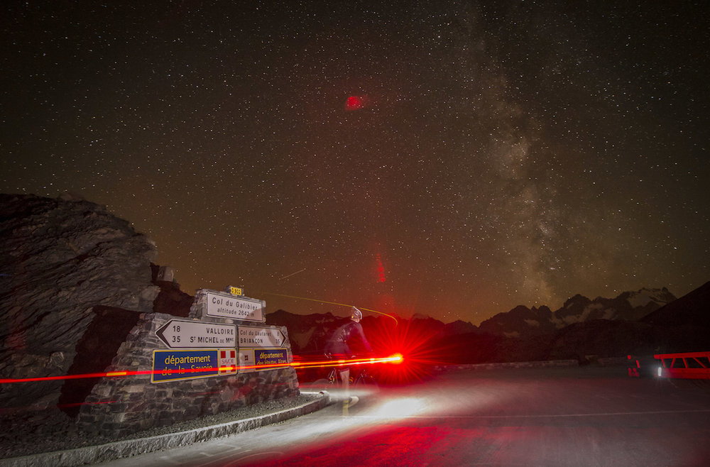 Mike at the summit of the Galibier at night during Les Alpes, 2013.