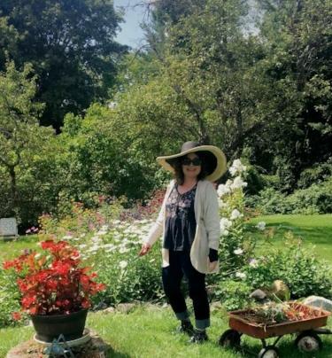 Stef in her garden.PNG