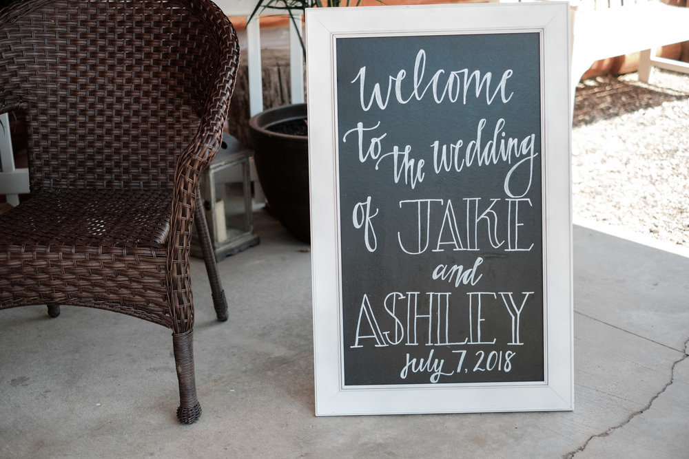 Chalkboard sign for wedding at Williams tree farm in roscoe, illinois
