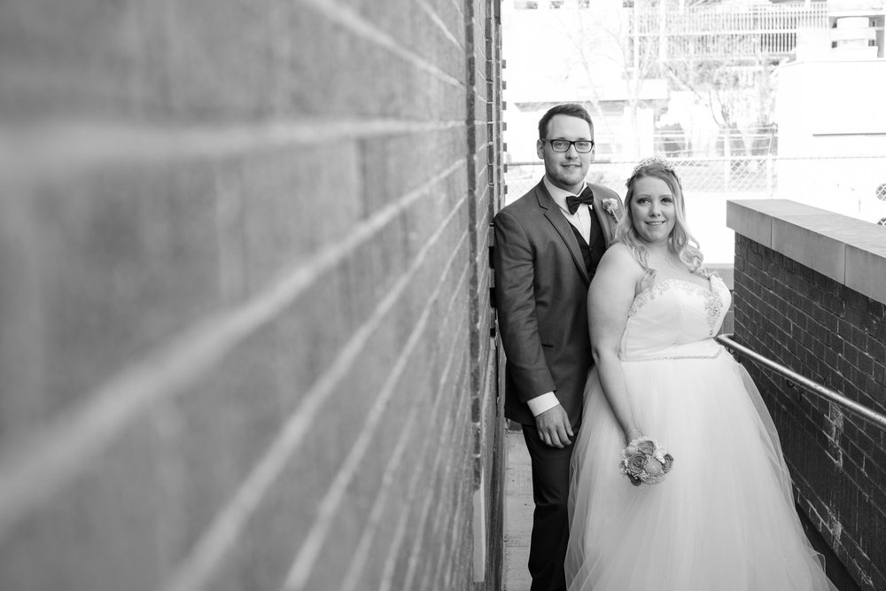 bride and groom portrait after wedding at the brink lounge in Madison, Wisconsin