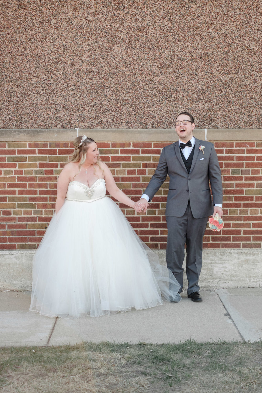 Bride and groom holding hands after wedding at the  Brink Lounge in Madison, Wisconsin
