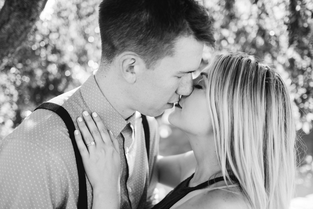black and white photo of couple nearly kissing during nashville engagement session