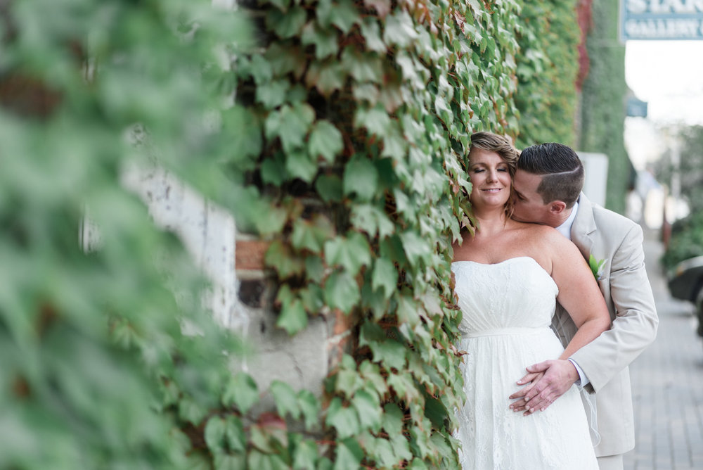 Bride and groom outside starline factory in harvard illinois