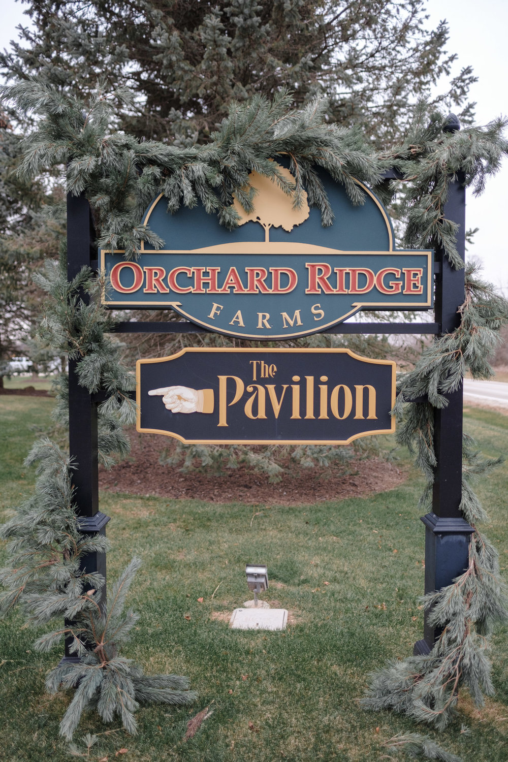 sign welcoming guests to a wedding at the pavilion at orchard ridge farms in rockton, illinois