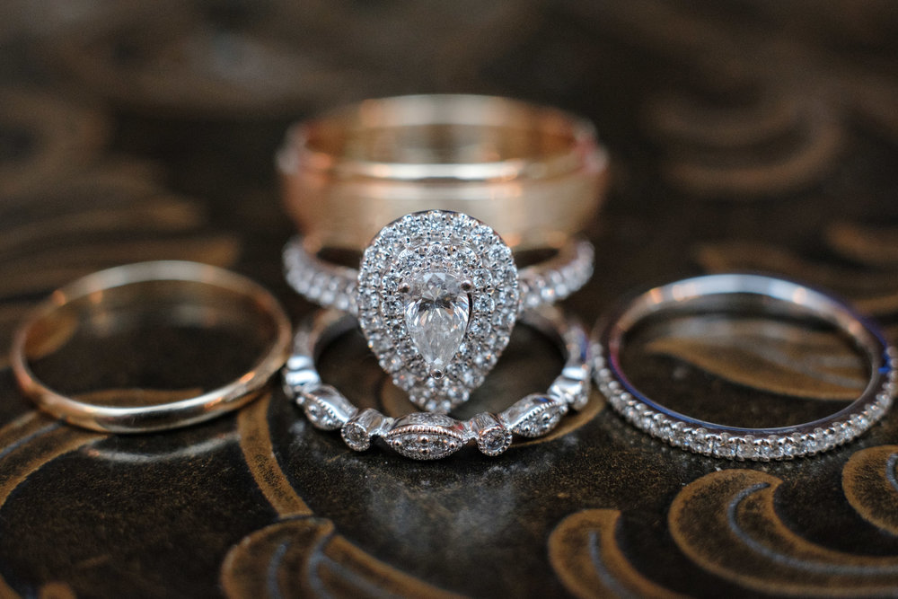 rose gold wedding rings and bands on table at the pavilion at orchard ridge farms in rockton, illinois