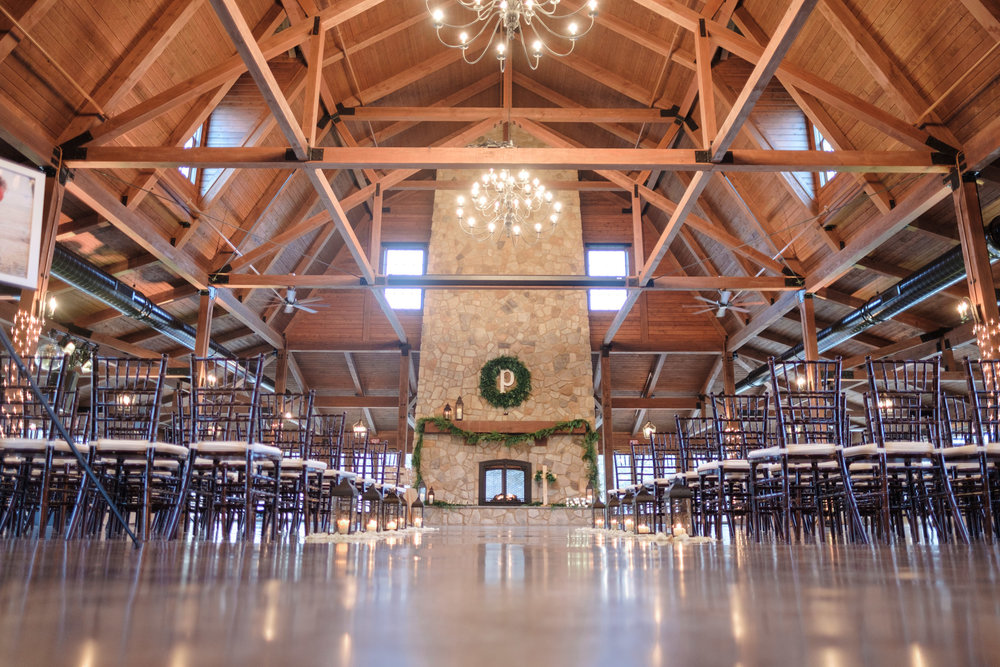 Decorated inside of the barn and mantle with large chandelier at the pavilion at orchard ridge farms in rockton, illinois