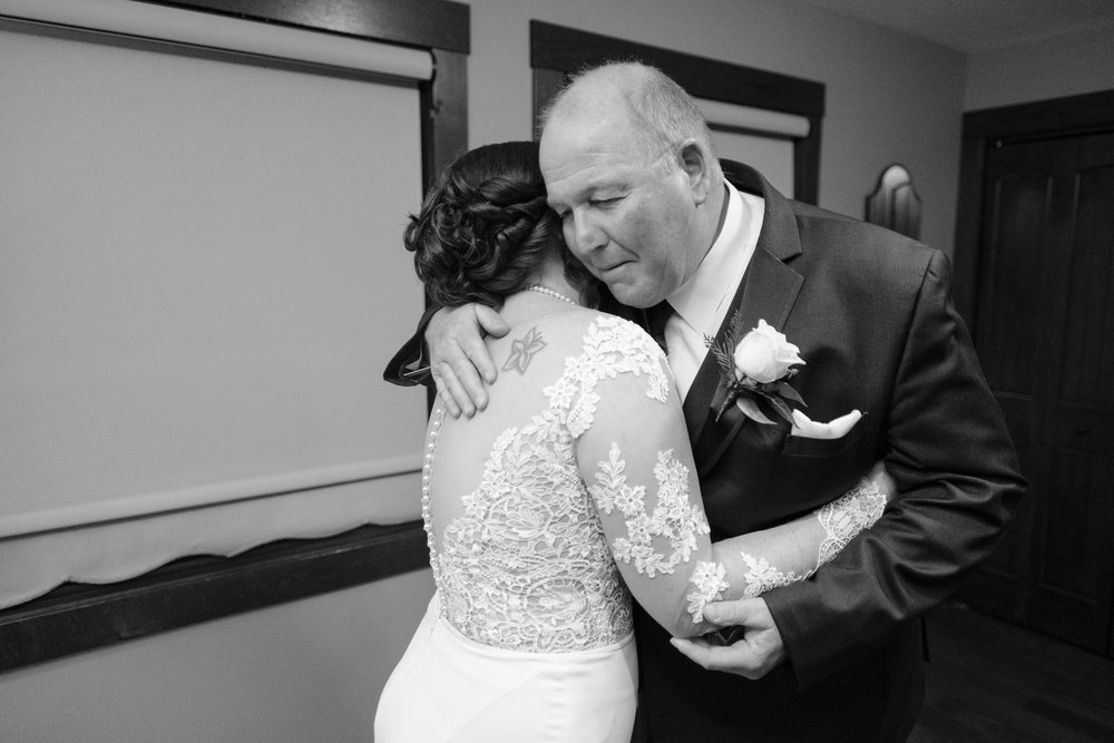 father daughter first look before her wedding at the pavilion at orchard ridge farms in rockton, illinois