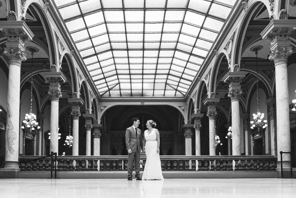 Bride and groom laugh during thier first look at the Indianapolis State House wedding.