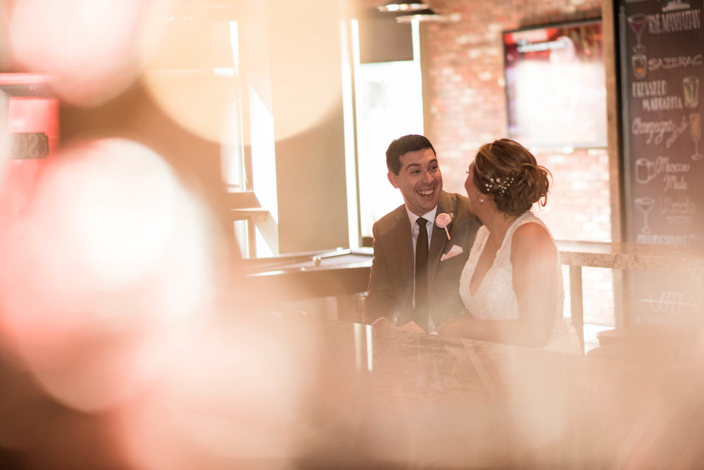 bride and groom enjoy a drink at omni severin hotel bar before reception