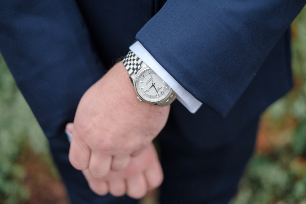 Groom details of watch and blue suit at Lake Geneva Resort