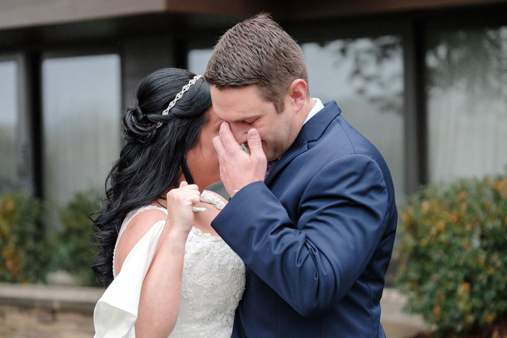 groom crying during first look at lake geneva resort wedding