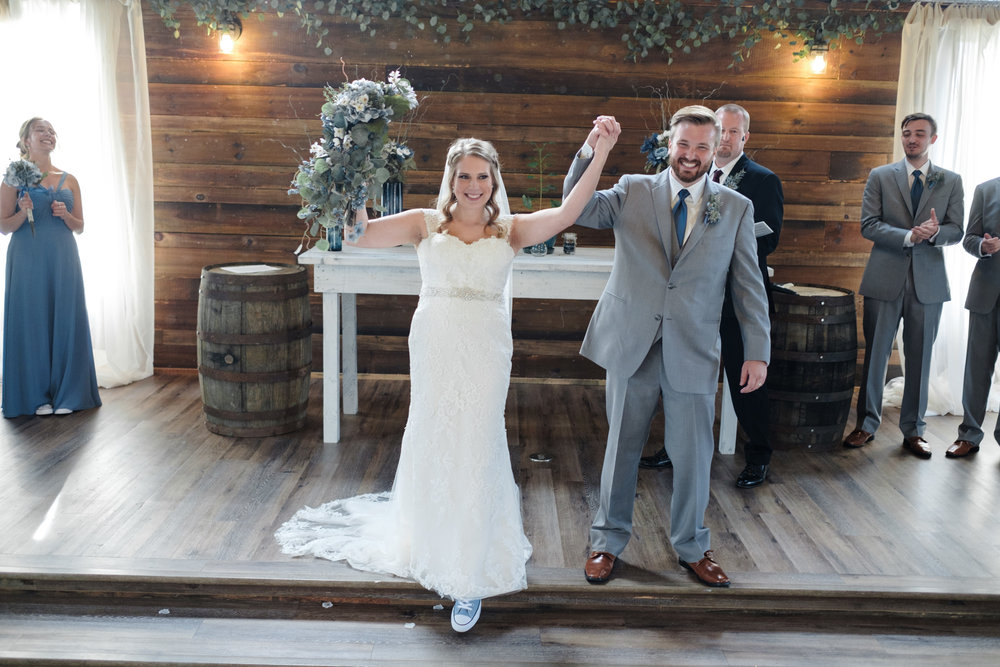 rockford wedding photographer captures  joy of couple after being presented as man and wife at the fields reserve