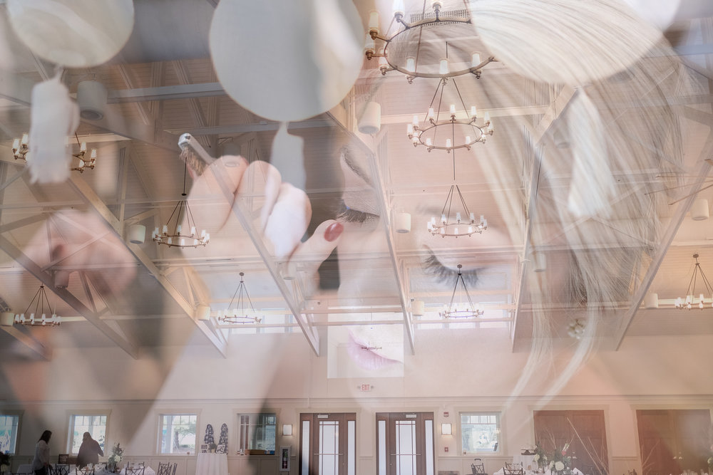 Double exposure of bride having makeup done at Rockford Bank and Trust Pavilion.