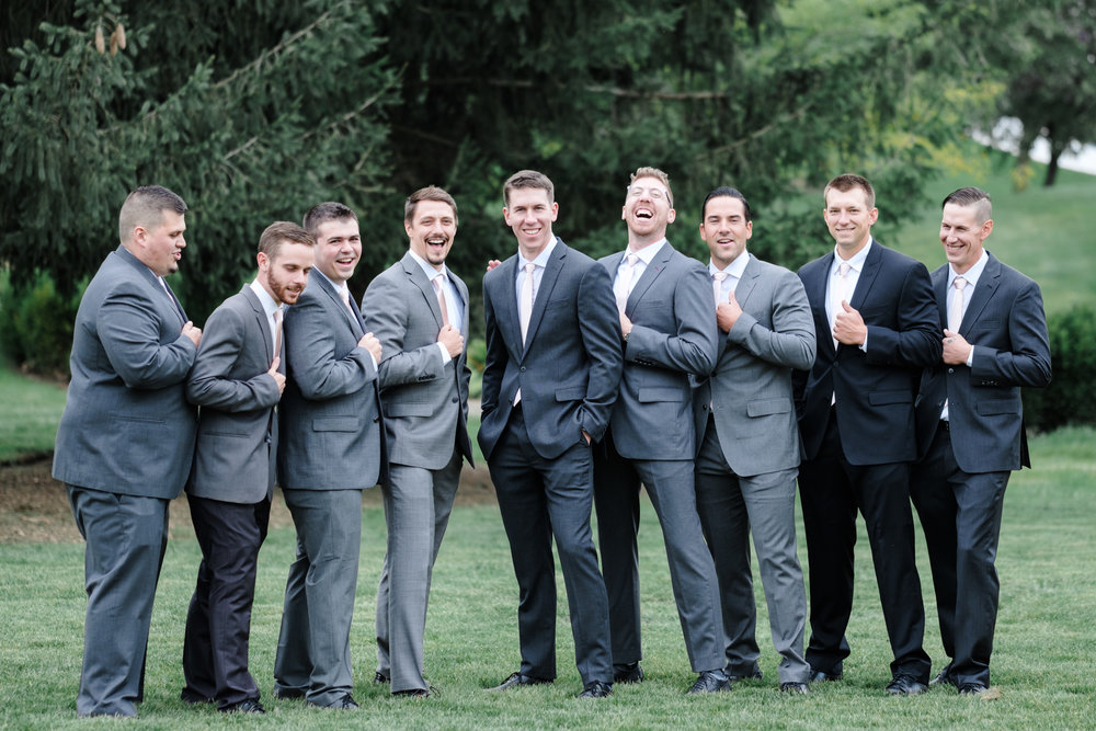 Groom and groomsmen laughing at Rockford Bank and Trust Pavilion.