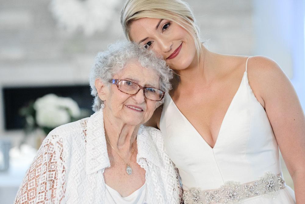 Bride embracing grandmother at Rockford Bank and Trust Pavilion.