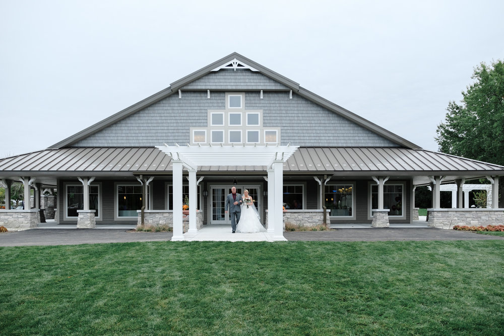 Bride and father walking to ceremony at Rockford Bank and Trust Pavilion.