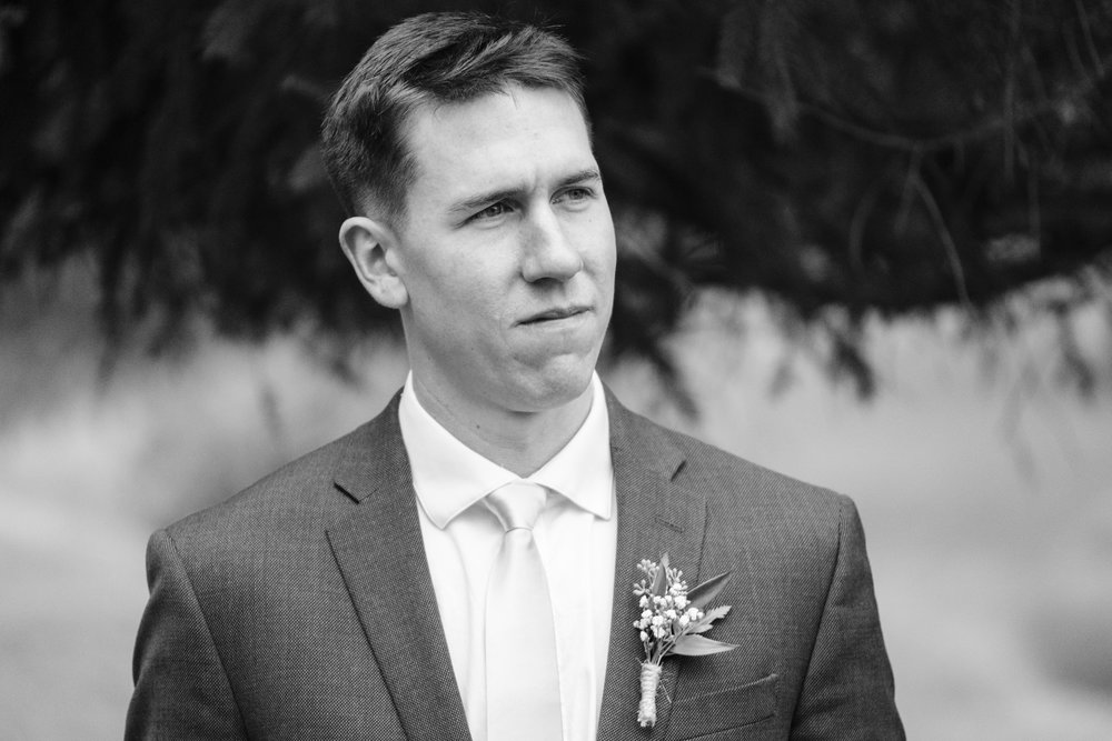 Groom getting emotional when he sees bride for first time on their wedding day at Rockford Bank and Trust Pavilion.