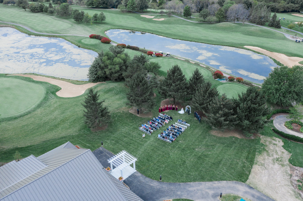 Aerial drone photo of an outdoor wedding in the summer at Rockford Bank and Trust Pavilion.