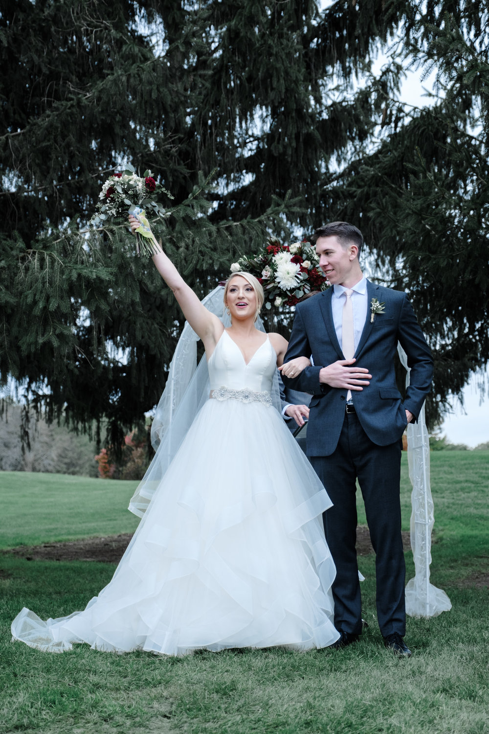 Bride and groom celebrate after saying I DO at Rockford Bank and Trust Pavilion.