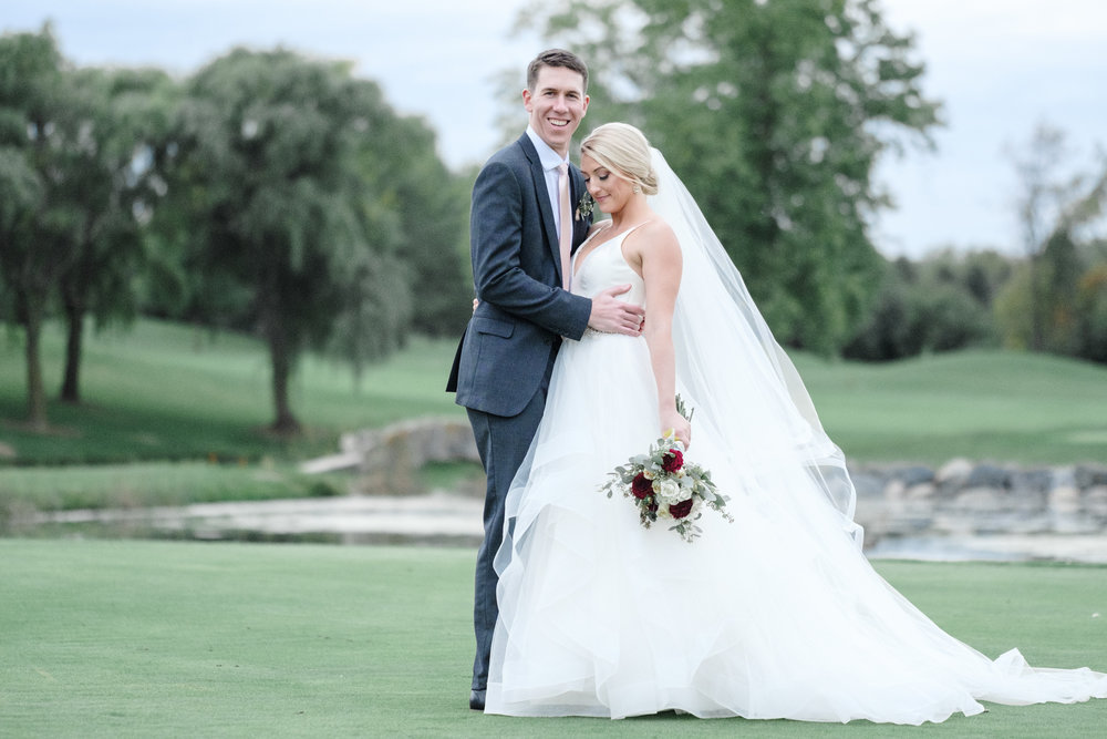 Groom laughing at Rockford Bank and Trust Pavilion.