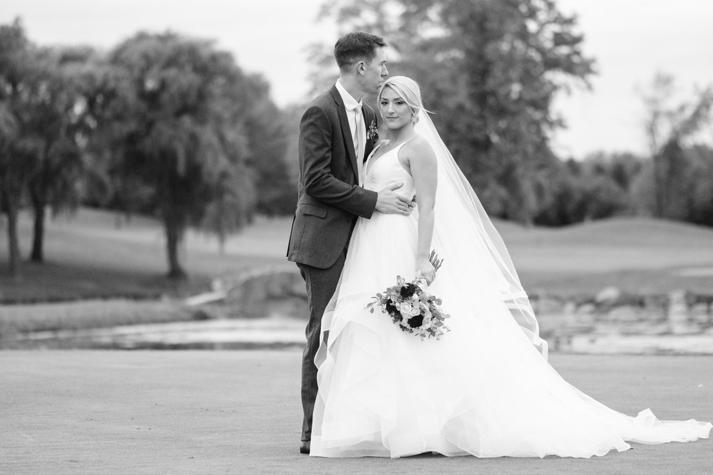 Black and white candid bridal portrait at Rockford Bank and Trust Pavilion.