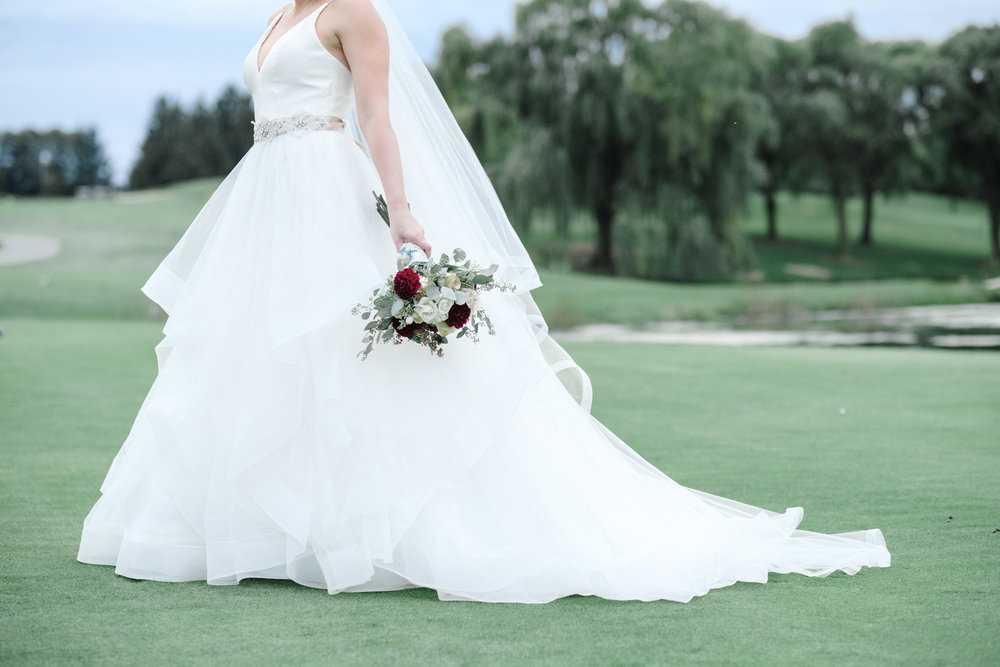 bridal portrait with beautiful floral arrangement by event floral at Rockford Bank and Trust Pavilion.