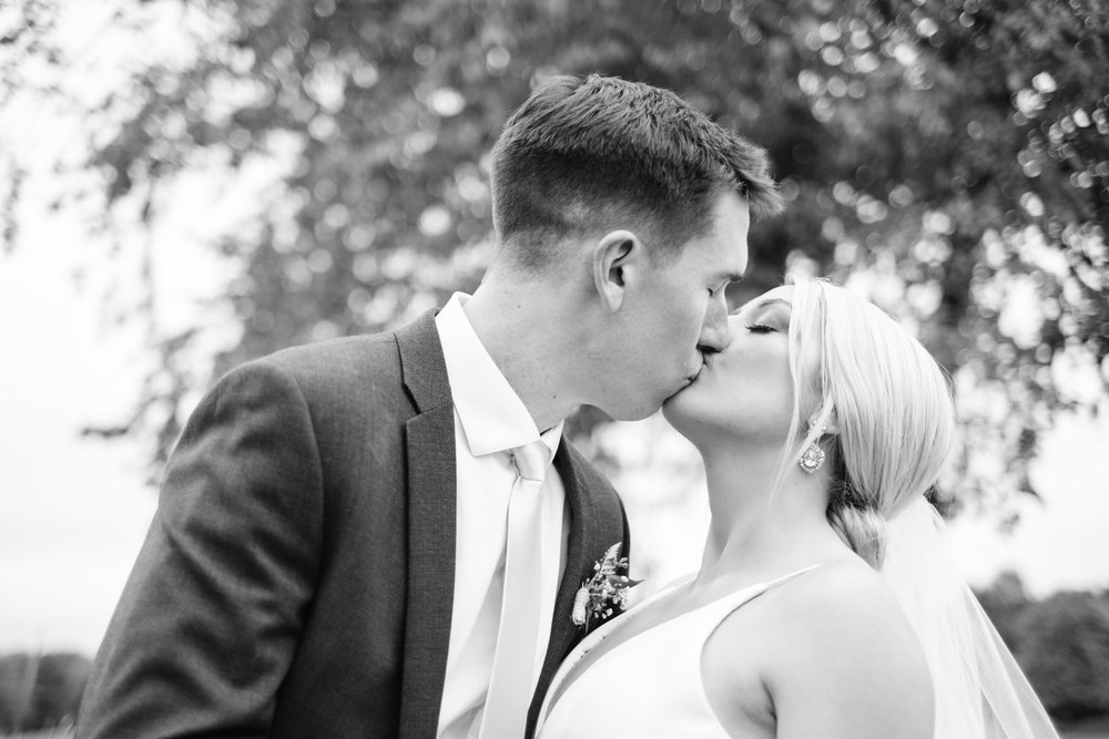 Bride and groom kissing at Rockford Bank and Trust Pavilion.
